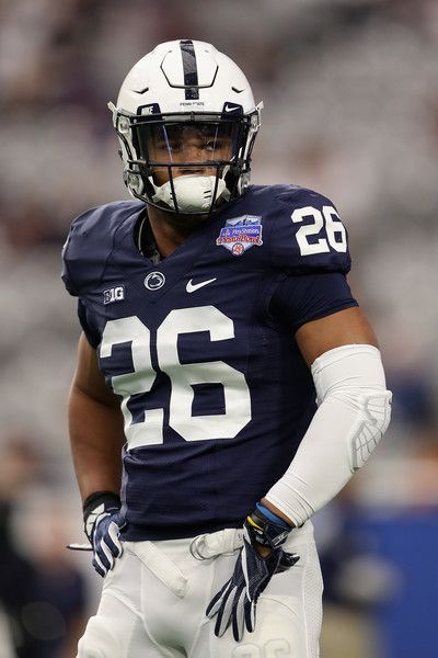 Saquon Barkley Photos - Running back Saquon Barkley  26 of the Penn State  Nittany Lions warms up before the Playstation Fiesta Bowl against the  Washington ... 46a65782e