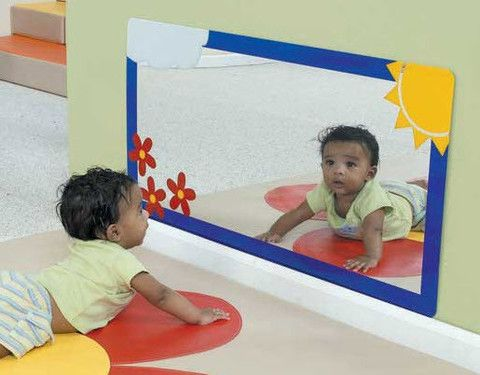 Toddlers will delight in the image of themselves in the Whitney Brothers Acrylic Mirror. Toddlers and young learners discover new movements as they gaze at their reflections. The acrylic mirror is sha