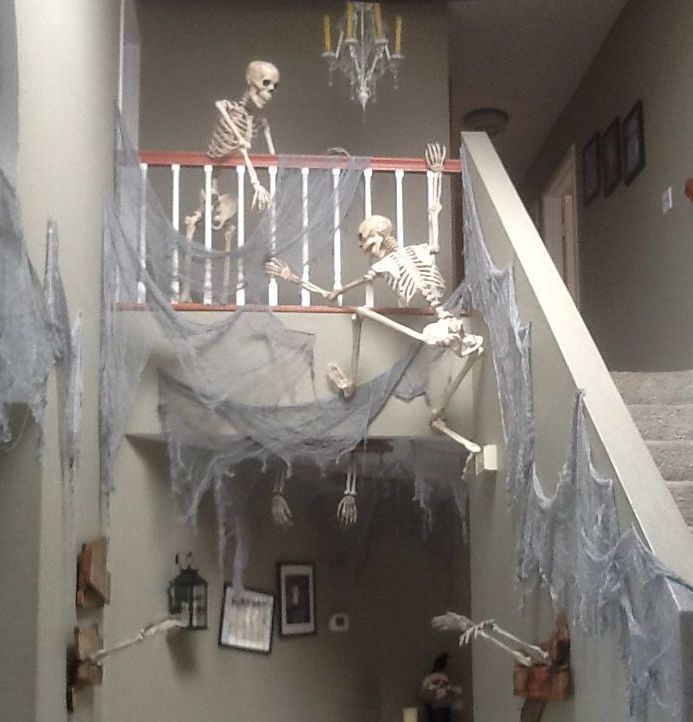 Skeletons climbing the stairs is rather bone chilling. See more party and Halloween decoration ideas at one-stop-party-ideas.com: