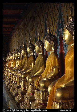 Row of Buddha statues in gallery, Wat Arun. Bangkok, Thailand