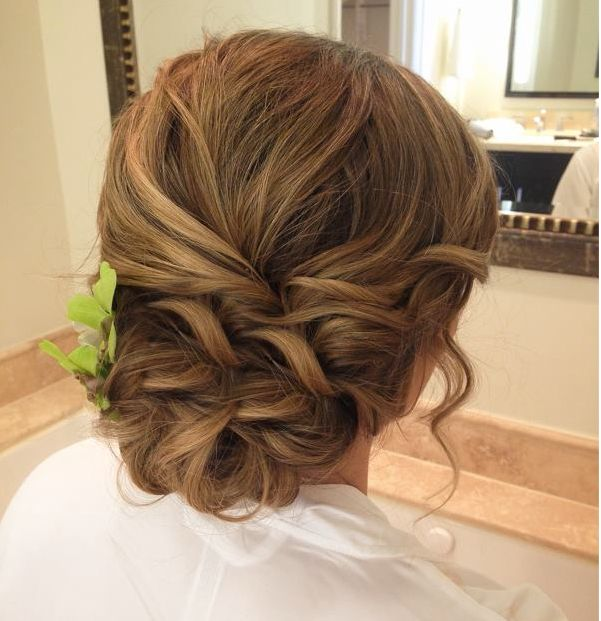 Curly low bun. Plus numerous other hair styles