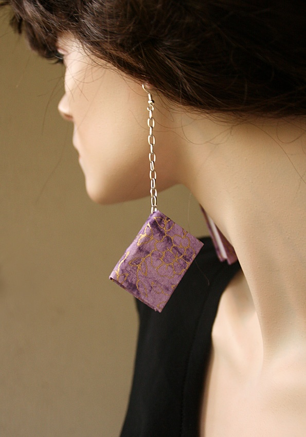 Handbinded book earrings made by Anu Myllynen