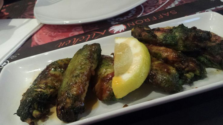 Barbecue wings with pistachio sauce at Lost Asia