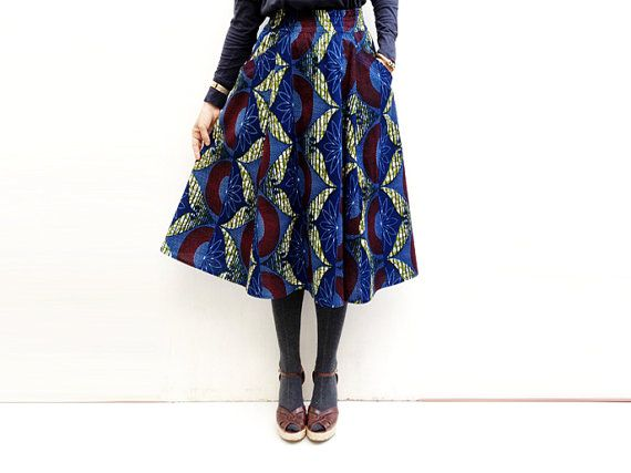 This stunning blue African print, in a very chic midi skirt, will add loads of style and elegance to any wardrobe! Its elastic waist and large