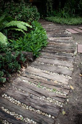 I like the stones & wood path, but I'd cover them with deck restore to  avoid slivers.