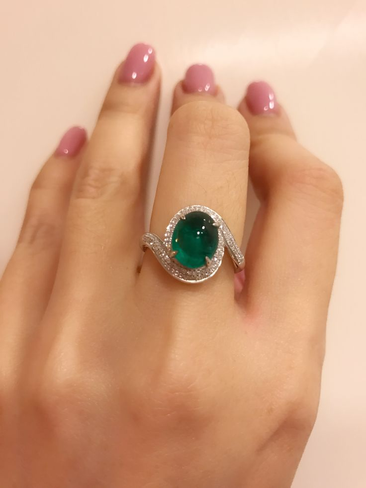 Vivid green oval cabochon emerald and diamond ring , the color is really pretty , like a candy