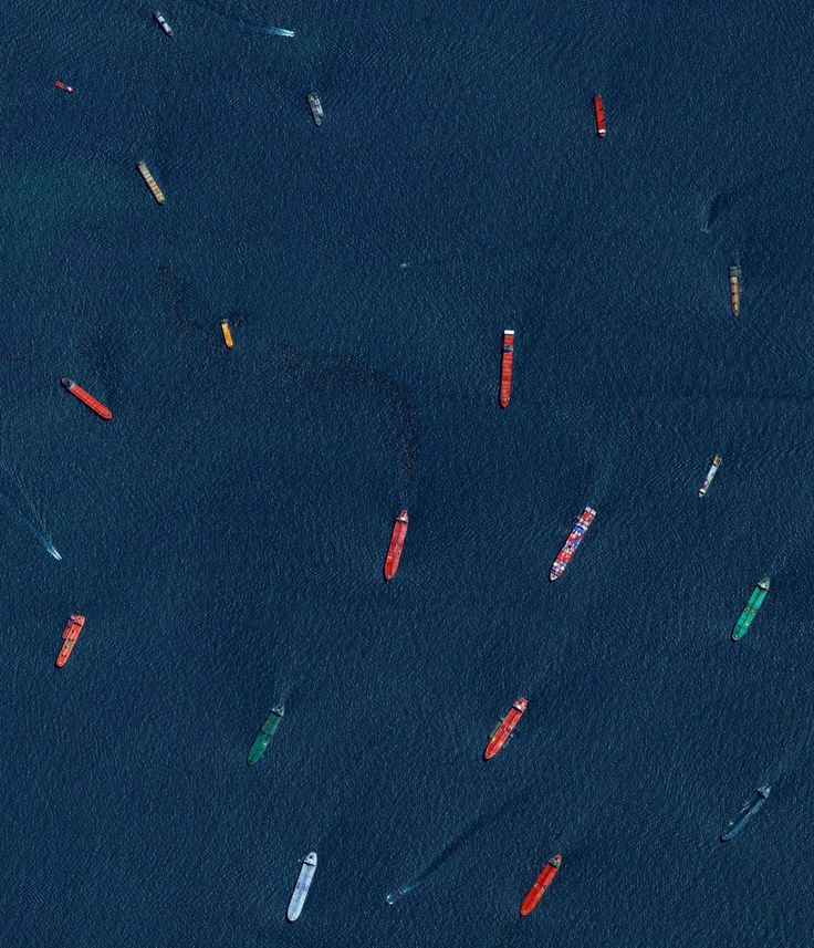 "dailyoverview: "" Cargo ships and oil tankers wait outside the entrance to the Port of Singapore. This is one of my favorites from ""Overview"" which is on sale right now for only $18.49 on Amazon when you use the coupon code ""HOLIDAYBOOK""..."
