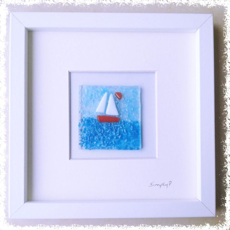"""Glass Fused Wall Art - Sailboat. SimplyP Glass Studio design and make a range of glass fused wall art in Dublin, Ireland. Glass Pictures This item is made by hand and contains layers of glass and frit which is tack fused in a glass kiln. You can touch and feel the object. The glass picture is 3""""x3"""" and frame is 8""""x8"""" Each glass picture is unique and may differ slightly."""