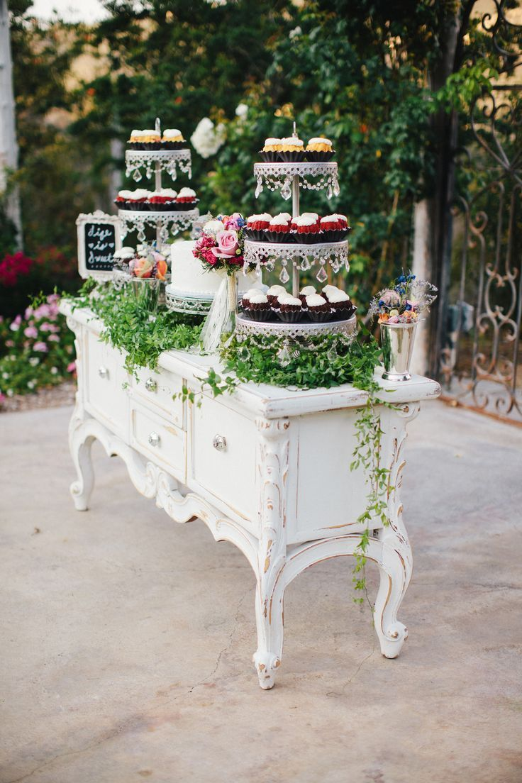 Wedding reception dessert table, shabby chic white buffet table, towers of cupcakes, white wedding cake // Zelo Photography