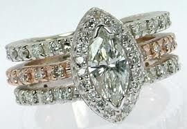 marquise halo ring - I like the 3 bands.