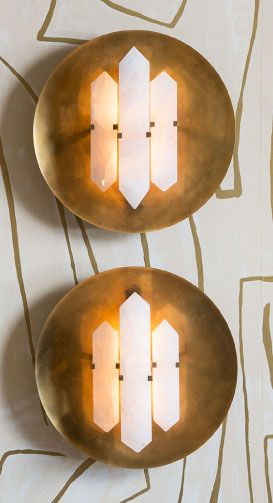 KELLY WEARSTLER | HALCYON ROUND SCONCE. Hand selected natural quartz stone set in a sculptural brass base.