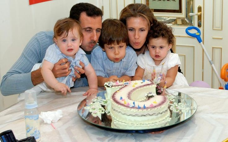 Bashar al-Assad celebrating the second birthday of one of their children with wife Asma Assad