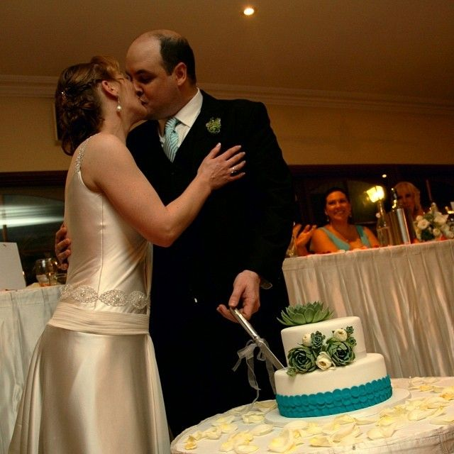 I guess the knife touched the bottom of the cake :: Photo by Nathania Springs Receptions :: Dandenong Ranges, Victoria, Australia