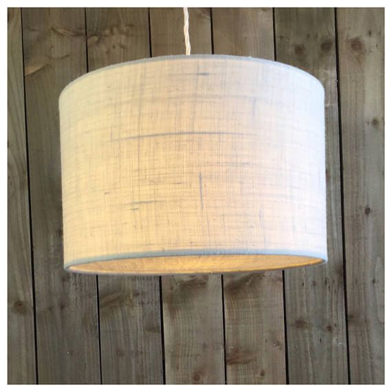 This stylish hessian lightshade & coordinating diffuser is handmade in our Bristol workshop from hessian fabric in cream. ▪️Fabric - cream Hessian ▪️Made to order within 5 working days ▪️ Measures - Various Sizes ▪️Diffuser included. Diffusers are perfect for when shades are hung from high ceilings, they draw the eye to the shade design rather than the frame & bulbs ▪️European fitting (40mm) with a British adaptor (28mm) will fit all types of lampholder ▪️ Energy saving bulb recomm...