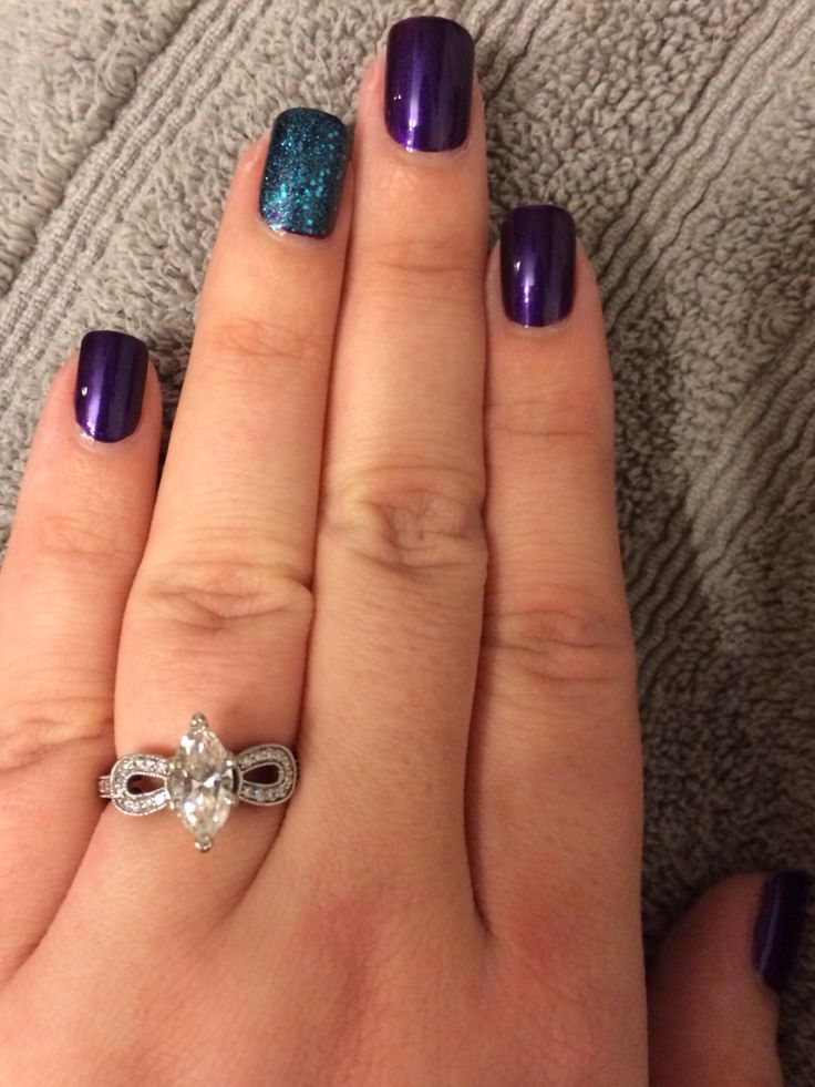 Loving my peacock nails! Dark purple with teal glitter accent nail.