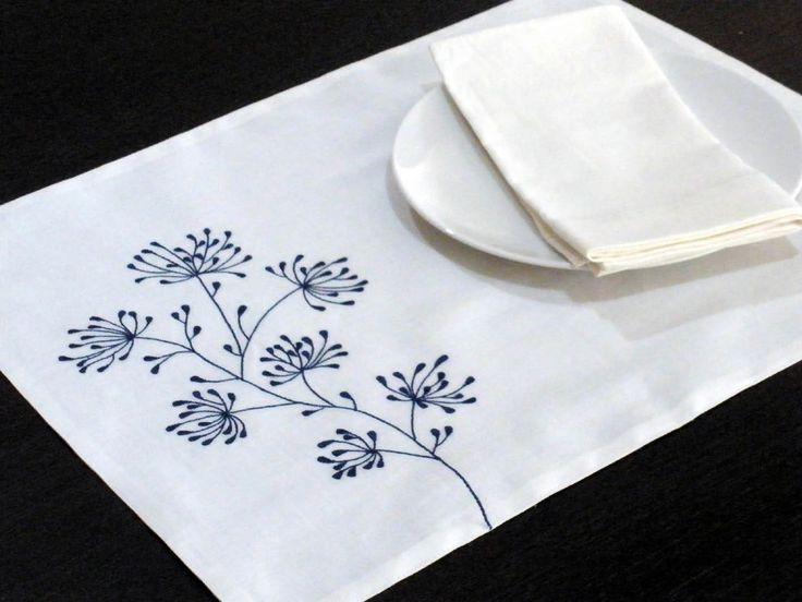 Blue Ixora Placemat -  White Linen with Blue Floral Embroidery - Placemat set of 4 - Linen Placemats - Embroidered Placemats. $32.00, via Etsy.