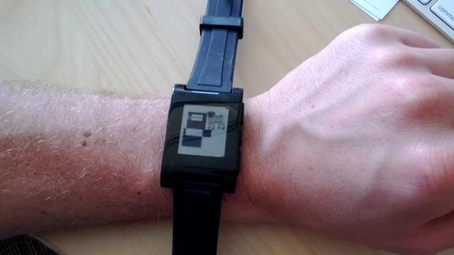 Pebble apps can run the gamut from useful to fun. Pug screensaver anyone? (Wristband is just one we had lying around.)