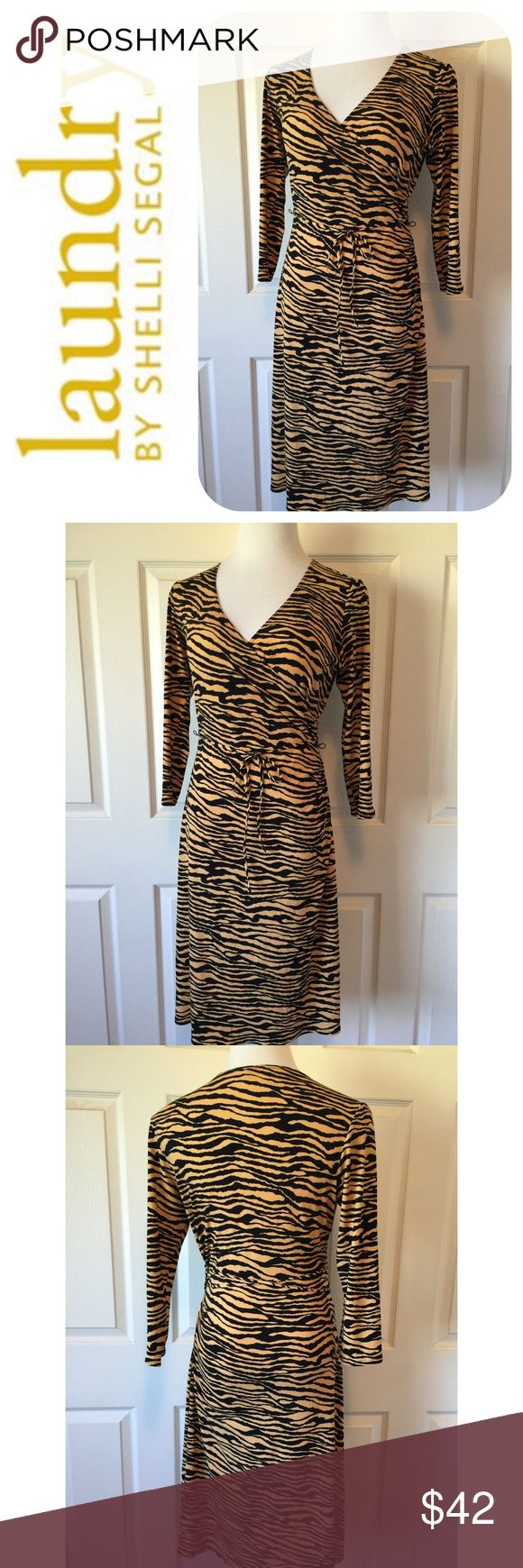 """LAUNDRY BY SHELLI SEGAL ANIMAL PRNT WRAP DRESS Beautiful Laundry By Shelli Segal Dress🔹V- Neckline🔹Faux Wrap🔹Size 8: 35"""" Bust, 45"""" Length, 28"""" Waist🔹Excellent Condition🔹Fabric: 98% polyester, 4% elasthane🔹Color: Mustard and Black🔹NO trades🔹Smoke Free Home🔹Bundle discount: 10% off two, 15% off three🔹Thank you for stopping by💕 Laundry by Shelli Segal Dresses"""