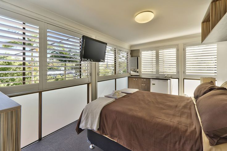 Outdoor Living Areas with Aluminum Shutters = Airflow while you sleep.