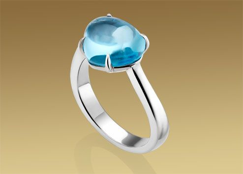 eden ring in 18kt white gold with topaz obviously