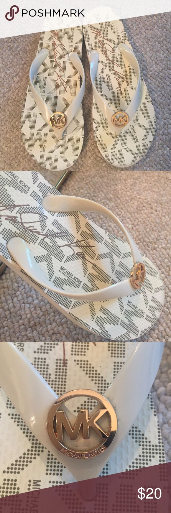 Michael Kors flip-flops Cream and gold Michael Kors flip flops. Worn a few times, visible wear on bottoms, but otherwise in great condition. Open to offers! Michael Kors Shoes Sandals