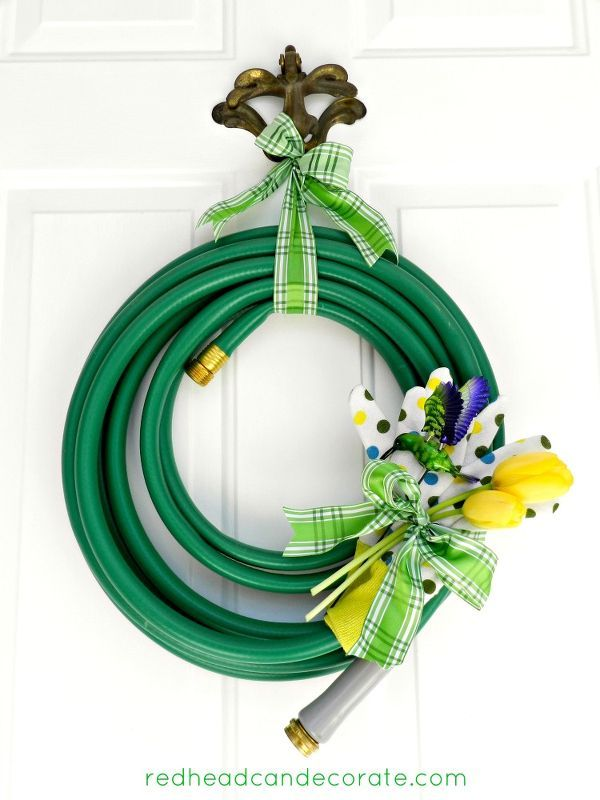 garden hose wreath, crafts, repurposing upcycling, wreaths, The ribbon not only held the wreath up on 1 nail on my door it held the gloves humming bird and tulips in place