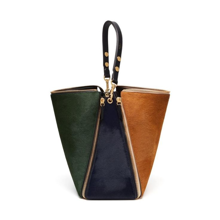 Discover the Camden bag in Caramel, Emerald, Burgundy & Midnight Haircalf, new for Autumn Winter 2016, the Camden's slouchy hobo style shoulder bag and statement zips were inspired by British punk rock culture. The zips travel down the sides and to the base of the bag where they fix together.