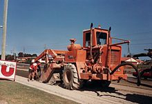 Soil Stabilizer / Road Recycler (Road Construction - Gluer, Crumbler) Digs and mixes soil with a bonding agent to make it harden to prepare for asphalt