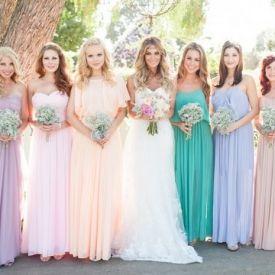 So romantic! Pretty pastel pleated bridesmaid's dresses and Baby's Breath Bouquets!  {Skyla Walton Photography}