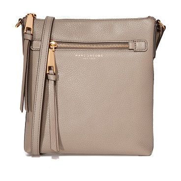 Recruit north / south cross body bag by Marc Jacobs. This skinny Marc Jacobs cross body bag is cut from pebbled leather. Zip front pocket and slim back pocket. Top zip an...