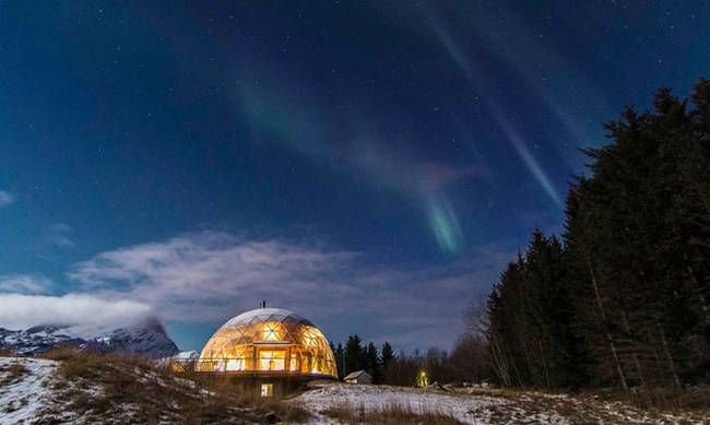 Cob House in Arctic Circle covered by geodesic dome to moderate temp