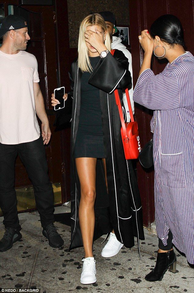Endless stems: The model showed off her long legs in a short black dress that she paired w...