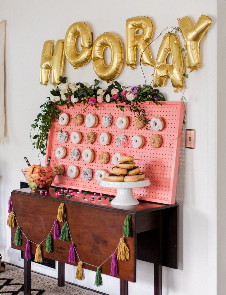 This bridal shower features tons of tropical elements, festive florals, vibrant pops of colors, and best of all, a donut wall!