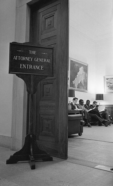 Four university students, l-r Tom Kahn, Courtland Cox, Stokely Carmicahel and Ed Knappman, began a sit-in in the outer office of Attorney General Robert Kennedy here today and said they would stay there until they received an appointment. Stokely Carmichael, of Howard University, said they wanted to discuss the case of Dion Diamond, a former Howard student now being held in a Baton Rouge, LA., jail on criminal anarchy charges, and to seek Kennedy's help in securing his release. March 1962.