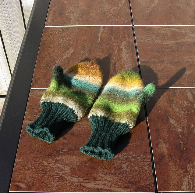 Noro felted mitts/unfelted cuffs - http://www.ravelry.com/projects/SandyHam/felted-mittens-with-unfelted-wool-cuffs-4