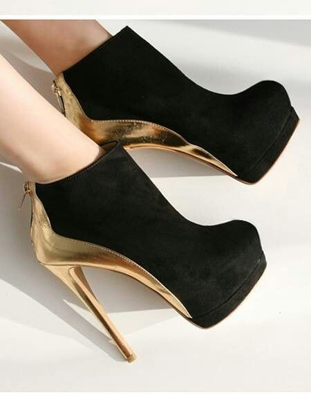black and gold stiletto high heels pumps women shoes fashion http://www.womans-heaven.com/black-and-gold-stiletto-heels/