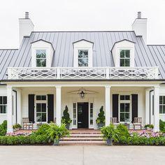 Home exterior design inspiration; white Hardie plank siding, black roof, black door, black shutters, black garage, thin pillars, dormers