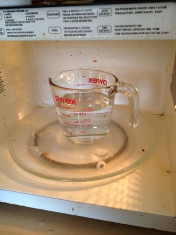 6 minutes to a clean microwave with 1 1/2 cups water and 1/2 cup vinegar