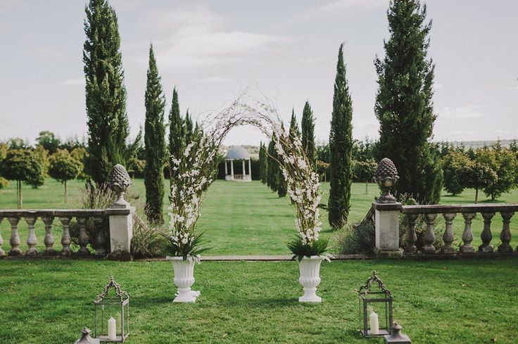 Orchid and Singapore orchid archway for a French Chateau wedding