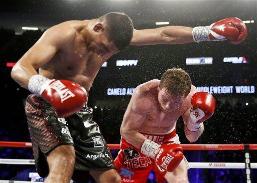Canelo Alvarez stops Amir Khan in 6th round