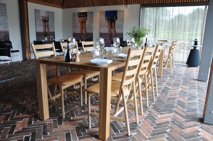 Long dinner table to Henne Kirkeby Kro. That is a Inn in Denmark with 12 special rooms.  http://www.kjeldtoft.com/