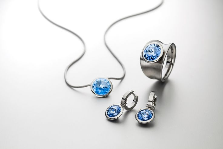 Set of pendant, earrings and ring made of fine stainless steel and blue swarovski® crystal.