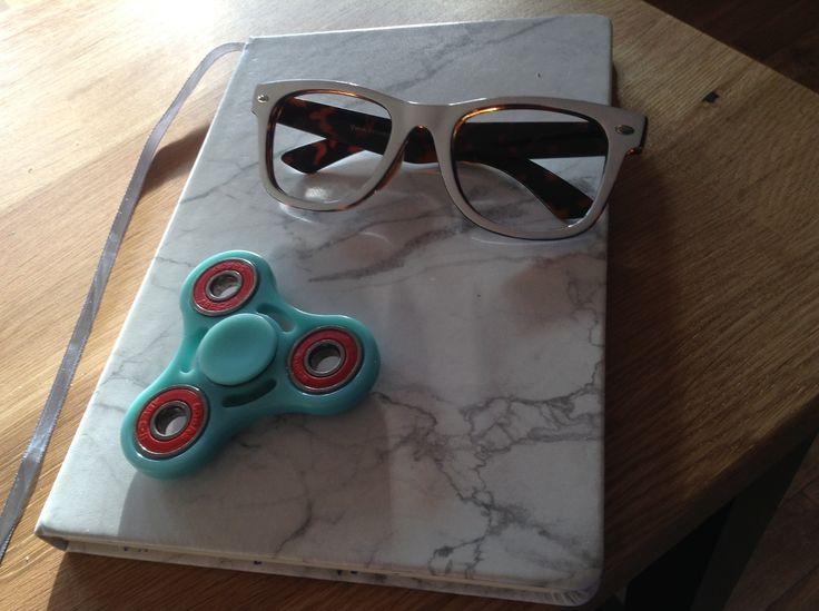 Book, fidget spinner and glasses!
