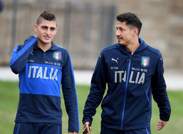 Marco Verratti (L) and Gianluca Lapadula of Italy chat during the training session at the club's training ground  at Coverciano on November 10, 2016 in Florence, Italy.