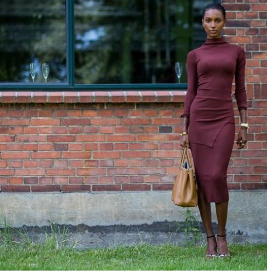 Model Jasmine Tookes wearing By Malene Birger Lionias blouse & Elinh skirt