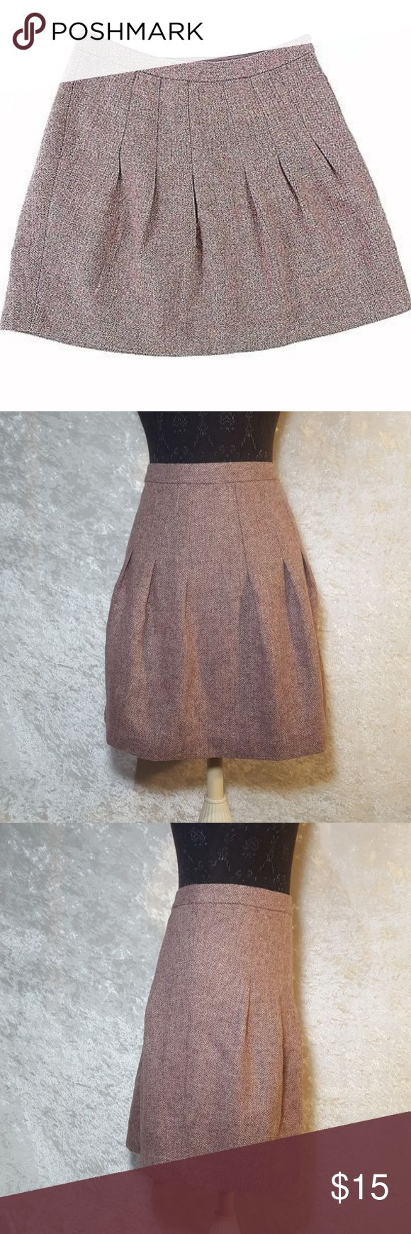 Gap Wool Skirt Size 10 by GAP skirt. 100% wool skirt with polyester lining.  Cute for fall and winter.  Tweed look with wine, lavender, and mauve color blend.  Used condition not brand new.  Feel free to ask questions or request more photos.  I do bundle discounts and accept offers.  Thanks for looking and happy poshing! GAP Skirts