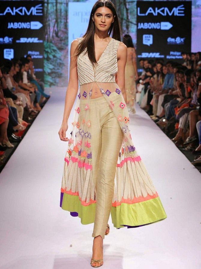 Esha Gupta puts her best foot forward :-) - Rediff.com