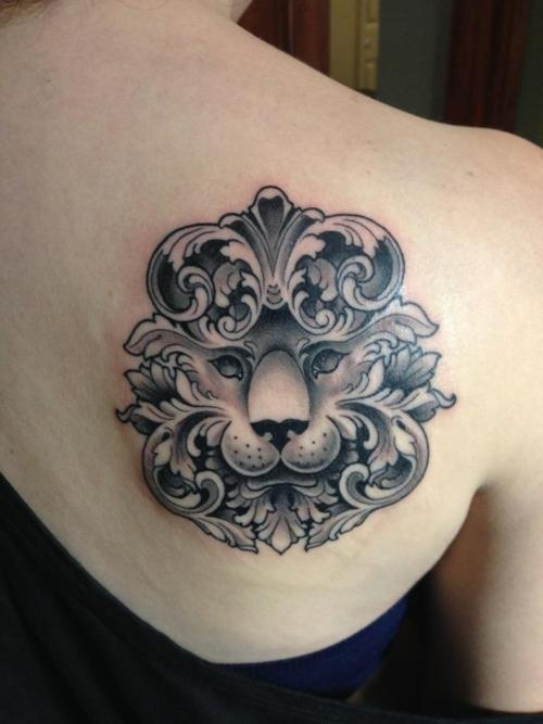 girly lion tat