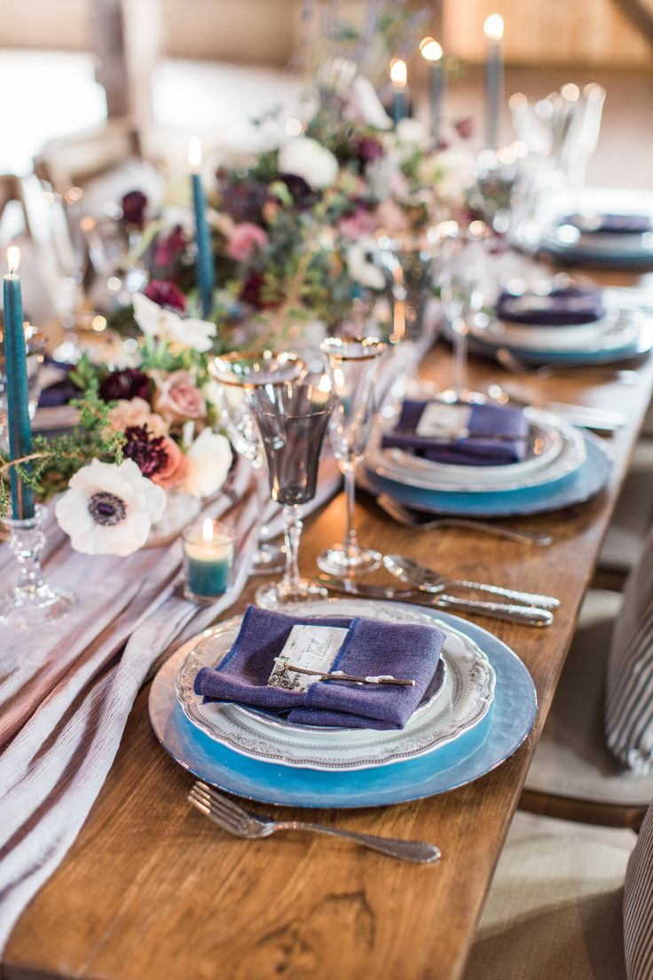 Barn reception table scape in burgundy and blue