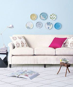 Toss a few large throw pillows onto your couch rather than a jumble of smaller ones for a cleaner design.